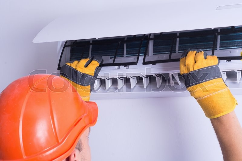 Placing back clean filter into air conditioner , stock photo