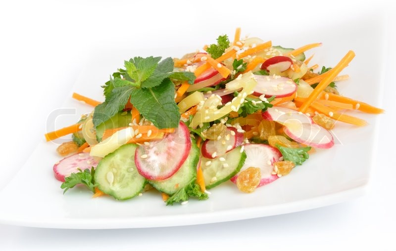 Stock image of 'A salad of carrot, radish, cucumber, raisins, sesame ...