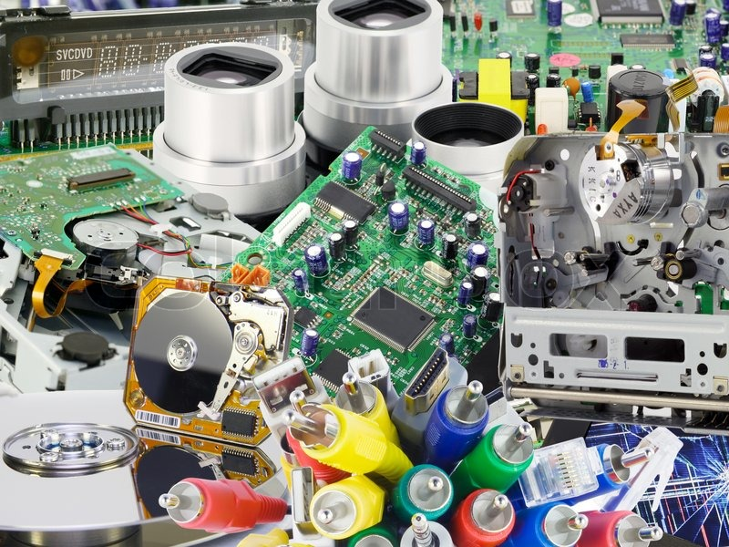 Stock image of 'The printed-circuit boards and electronic spare parts  from modern digital devices collage background. Mass production.'