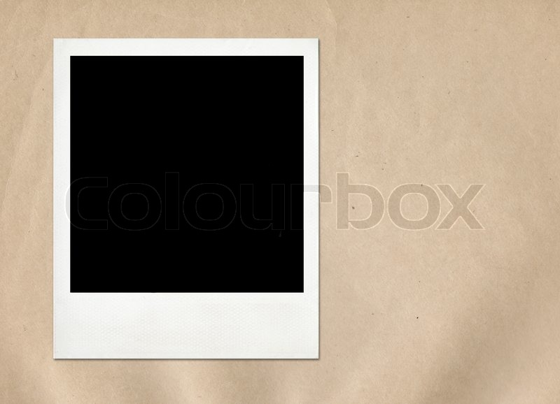 Instant frame on old paper background   Stock Photo   Colourbox