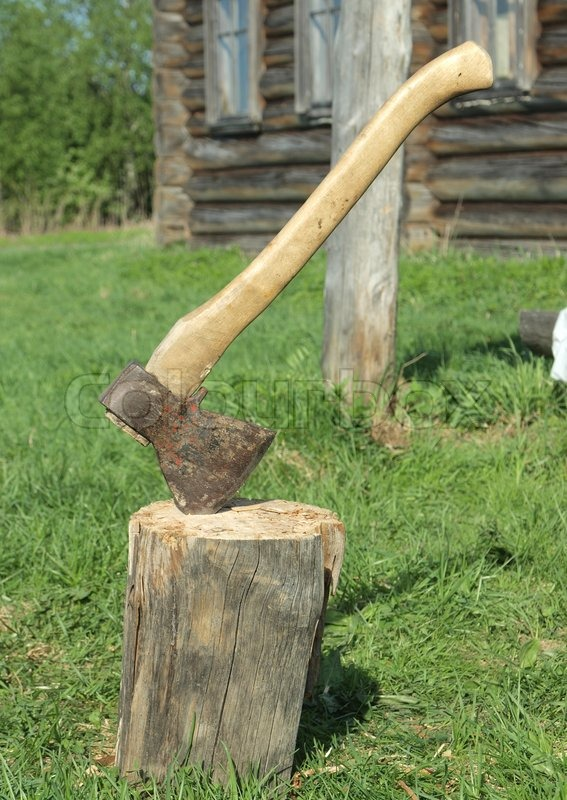 Photo of axe in the stump | Stock Photo | Colourbox