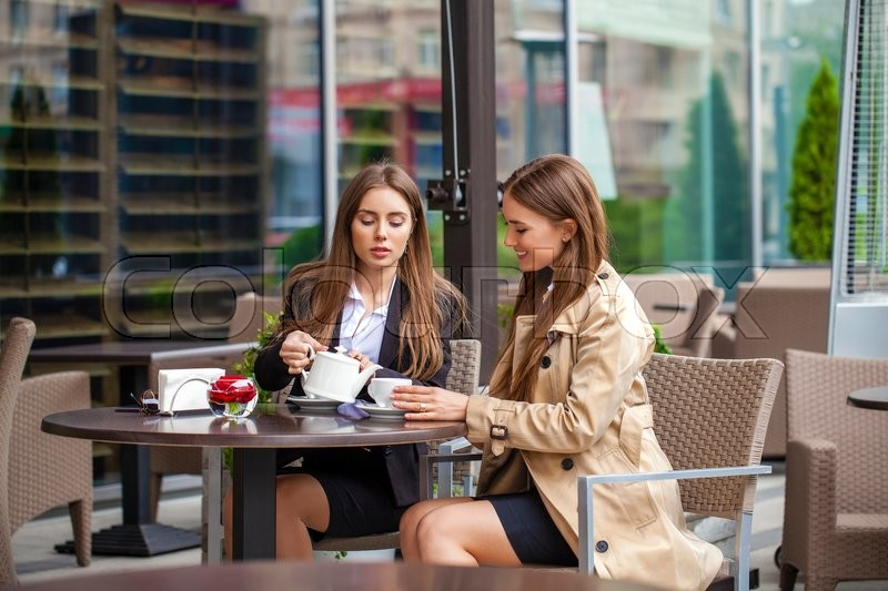Two Young Business Women Having Lunch Stock Photo
