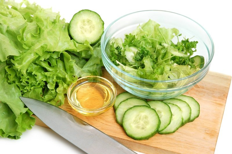 Fresh Tasty Lettuce, Vegetable Oil And Cucumber On A Cutting Board On White  Background