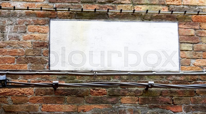 Blank sign on brick wall in Venice, Italy, stock photo