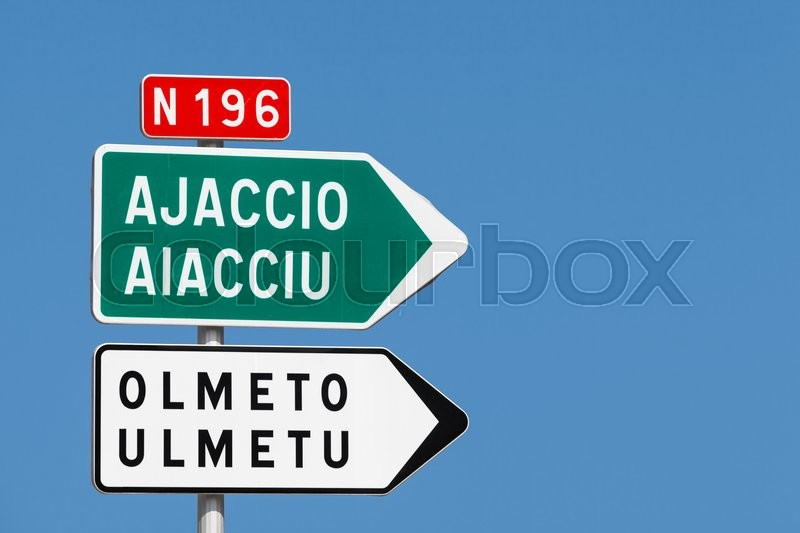 road sign white and green arrows with destination cities names and