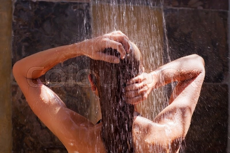 Woman in the shower, back side of young female showering under refreshing water, healthy lifestyle, enjoying time in luxury spa resort , stock photo