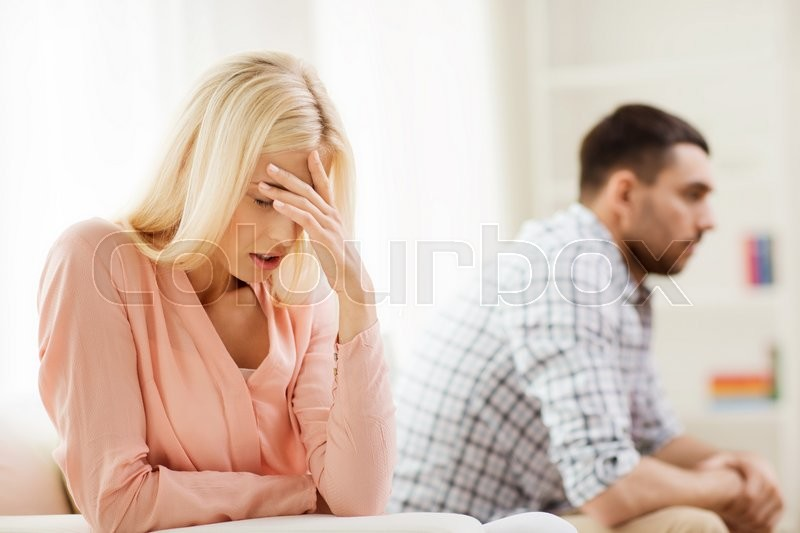People, relationship difficulties, conflict and family concept - unhappy couple having argument at home, stock photo