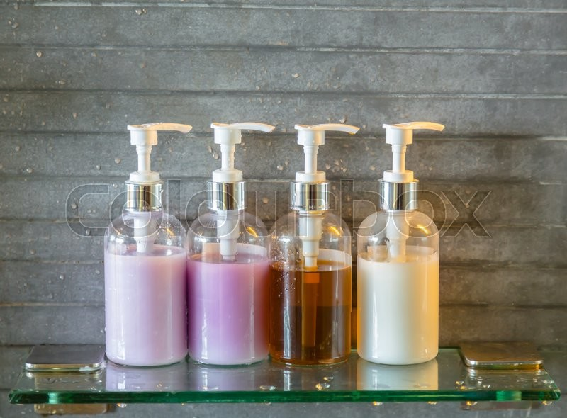 Shampoo bottles in a bathroom ( Filtered image processed vintage effect. ),  stock photo