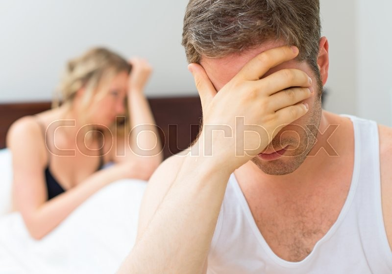 Upset young couple having problems with sex, stock photo