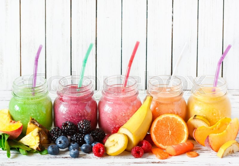 Healthy smoothies with fresh ingredients on a kitchen board, stock photo