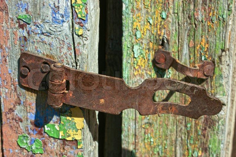 Old Rusty Lock On The Wooden Door Stock Photo Colourbox