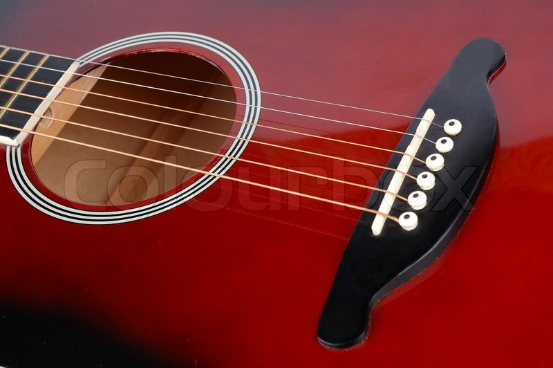Red Acoustic Guitar With Copper Strings
