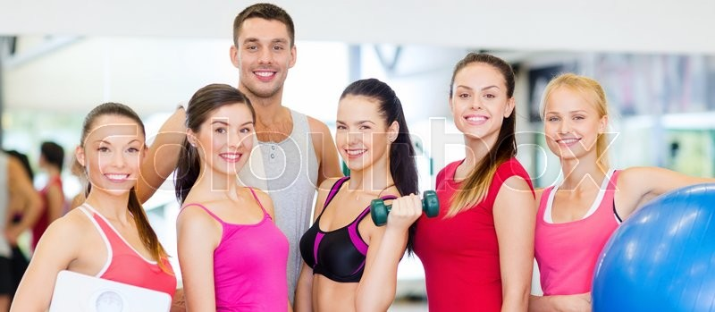 Fitness, sport, training, gym and lifestyle concept - group of smiling people in the gym, stock photo