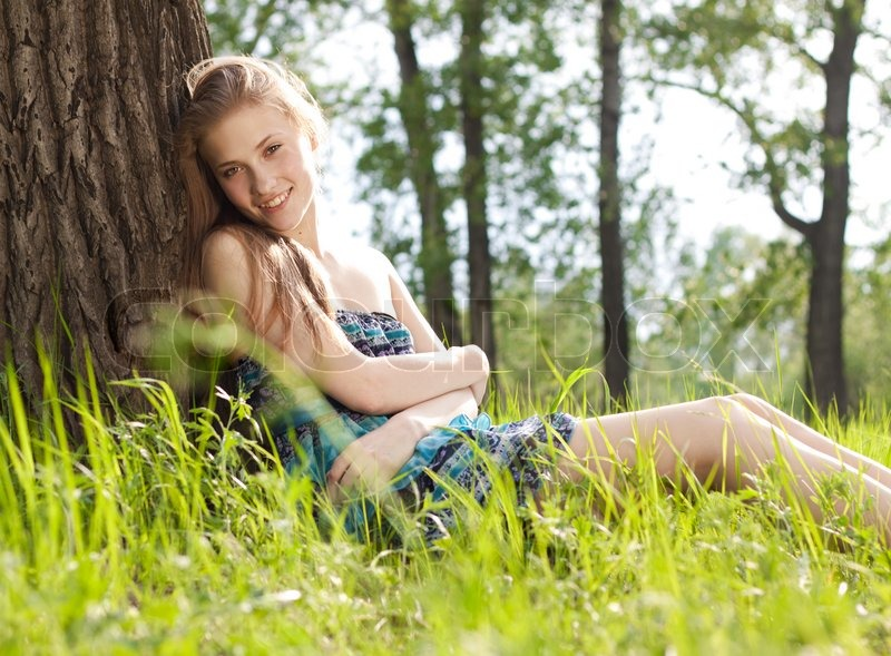 Beautiful Teen Girl In Blue Dress On The Meadow Stock