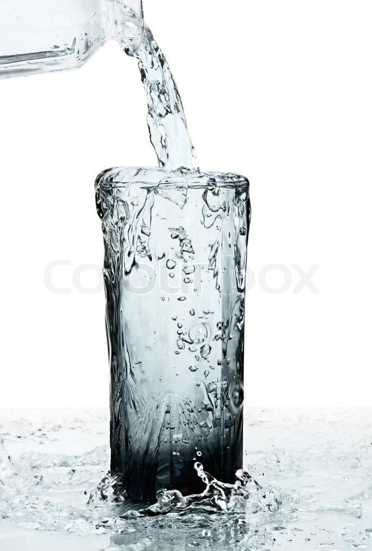 glass of a water with overflow on white background stock photo colourbox. Black Bedroom Furniture Sets. Home Design Ideas