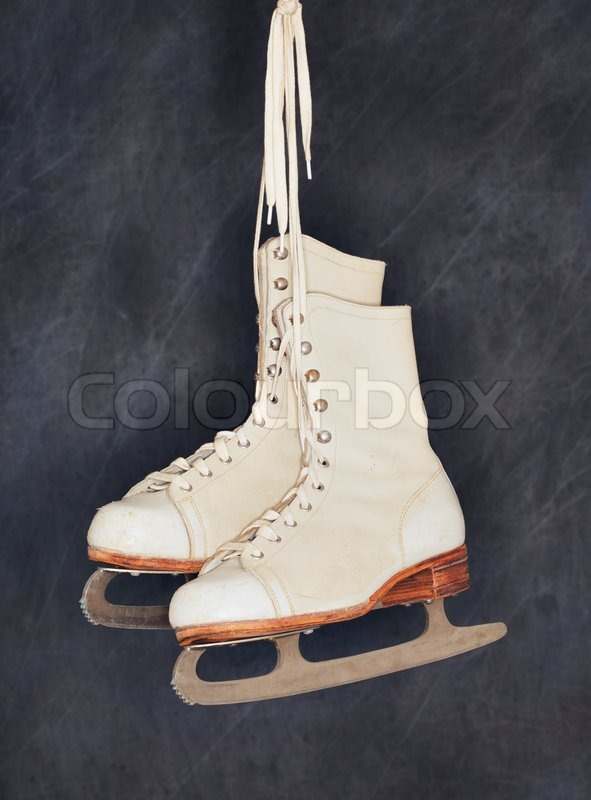 Old womens figure skates hanging from their laces | Stock ...