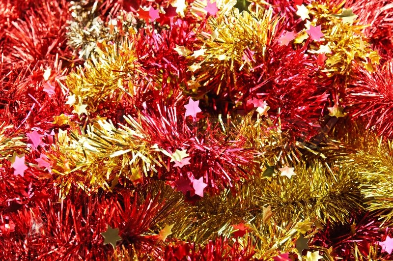 Background from red and yellow christmas tinsel stock
