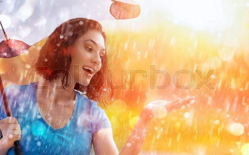 A smiling woman happy rain, stock photo
