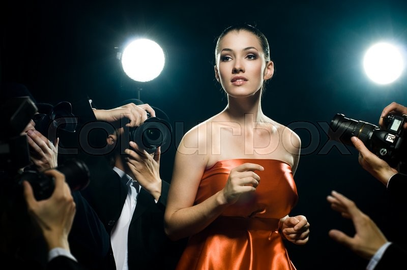 Photographers are taking a picture of a film star , stock photo