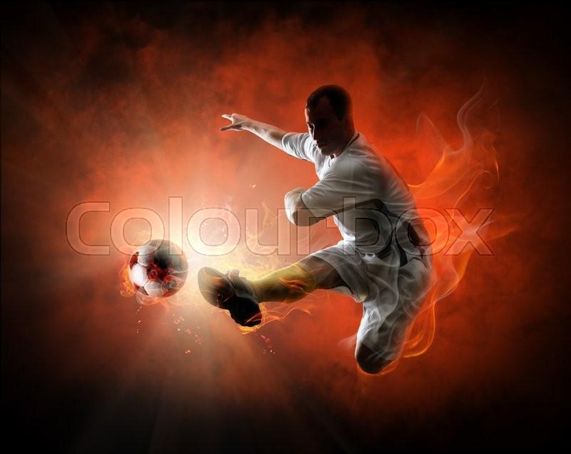 Soccer player kicking the ball, stock photo