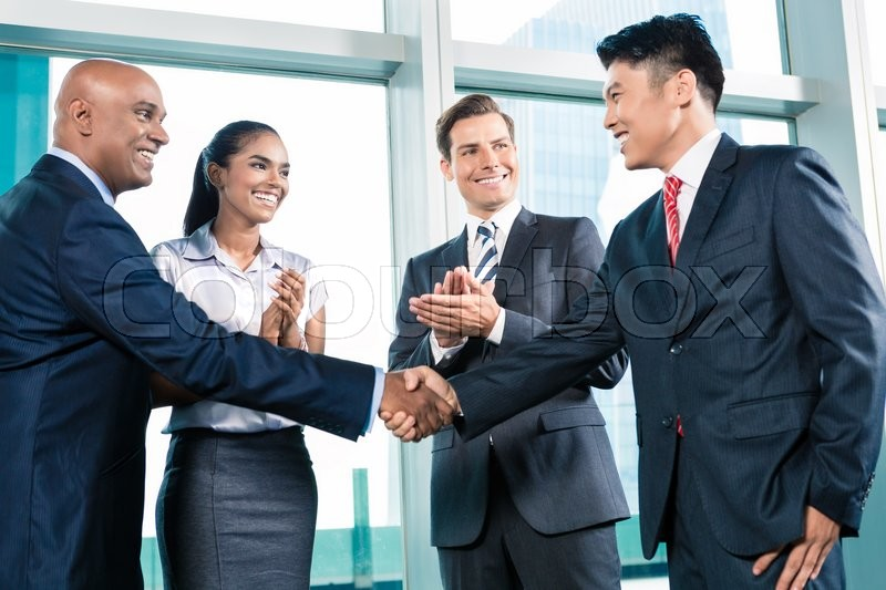 Business handshake in lofty office with city view, a deal is struck , stock photo