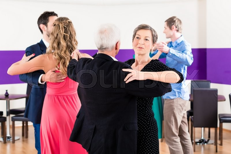 Group of people dancing in dance class having fun, stock photo