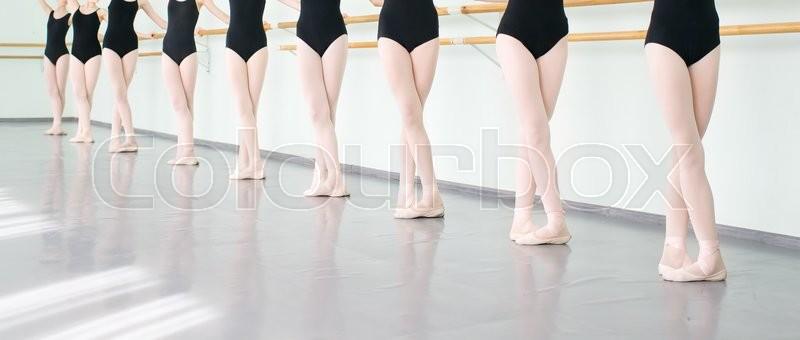 Legs of young dancers ballerinas in class classical dance, ballet, stock photo