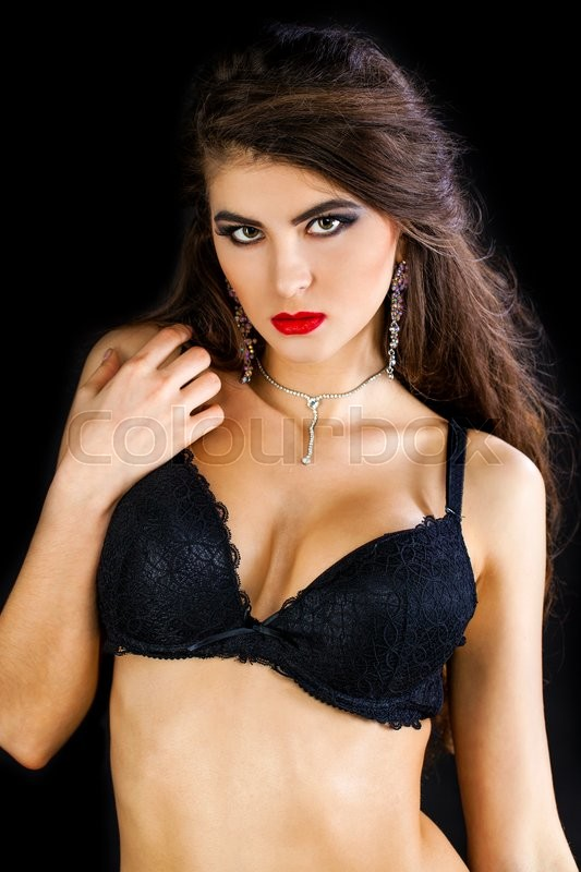 Fashion portrait of a professional model in black sexy underwear, isolated on dark background, stock photo