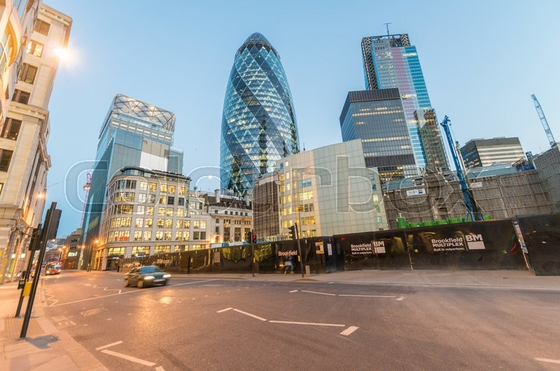 LONDON - JUNE 12, 2015: City of London skyline at dusk. London attracts 50 million people annually, stock photo