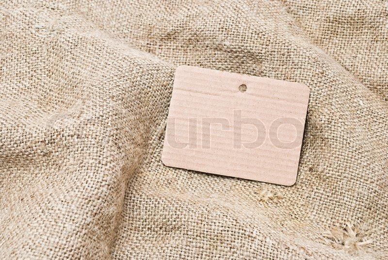 Sackcloth and cardboard tag, stock photo