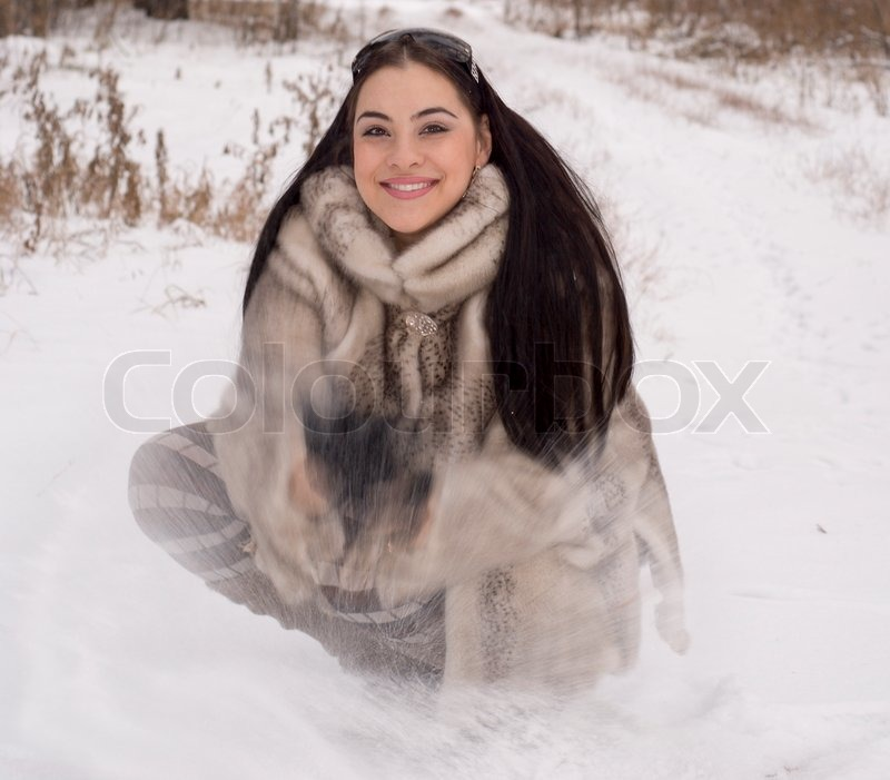 The smiling girl in a fur coat | Stock Photo | Colourbox