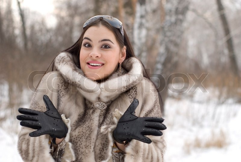 Young woman in a fur coat | Stock Photo | Colourbox