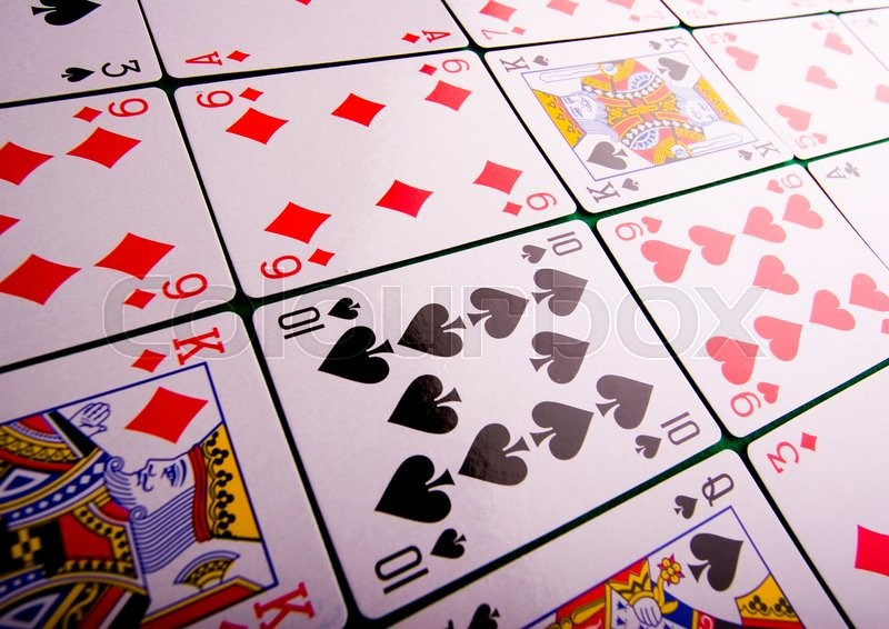 A game of cards, ambient light saturated theme, stock photo