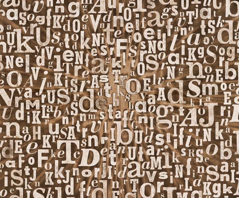grunge and gritty background texture made of old printed letters stock photo