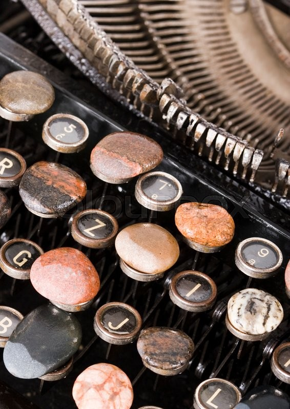Old retro typewriter on wooden desk, stock photo