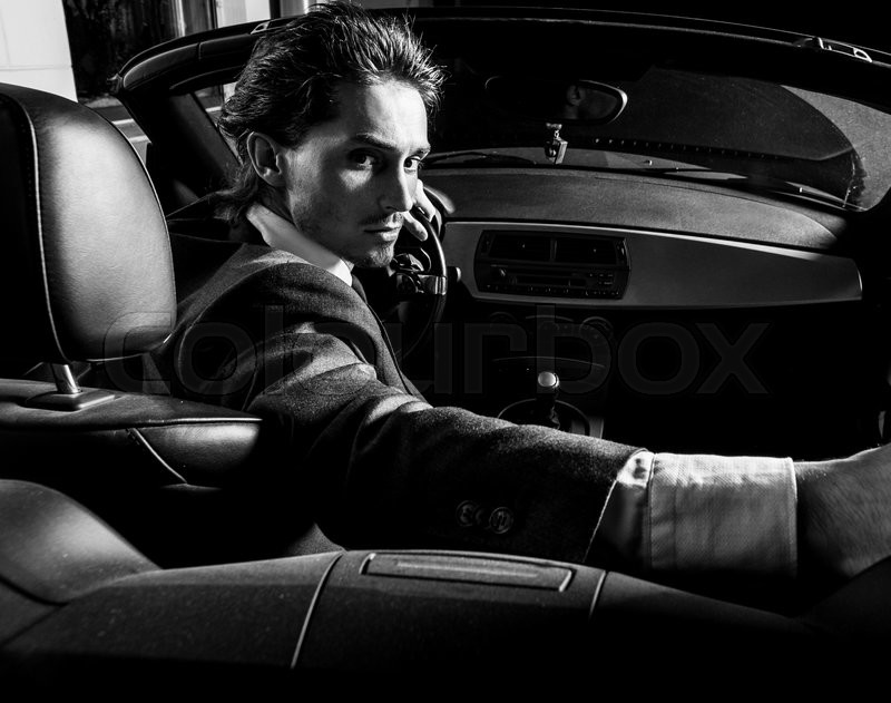 Handsome Man With Beard In Suit Driving Car Stock Photo Colourbox