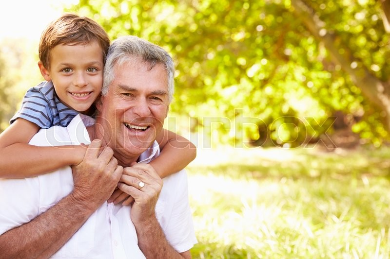 Grandfather having fun outdoors with his grandson, portrait, stock photo