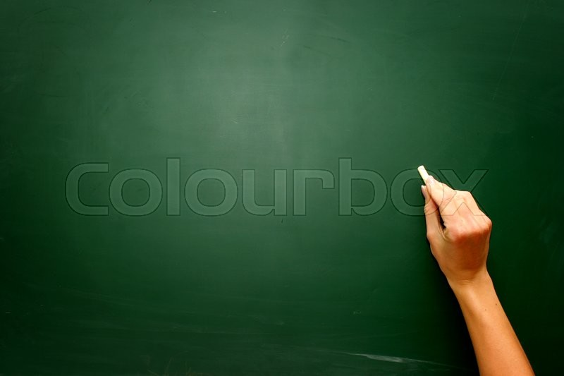 Female teen hand to draw something on blackboard with chalk , stock photo