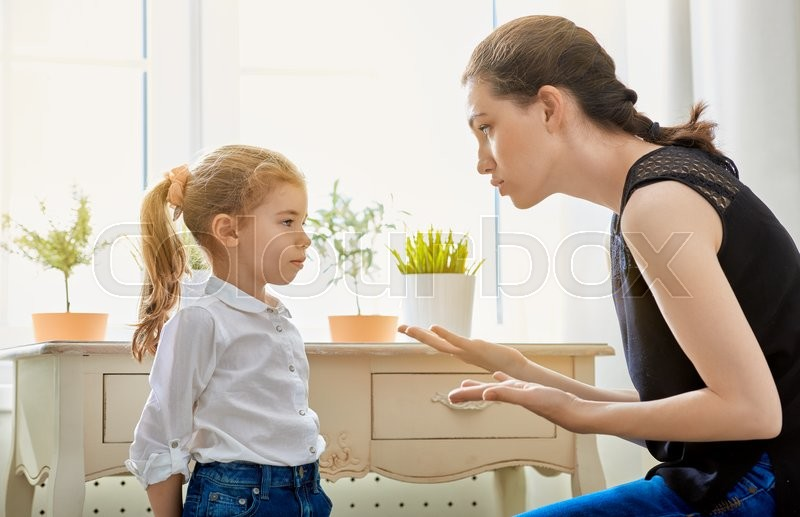 Mother scolds her child, stock photo