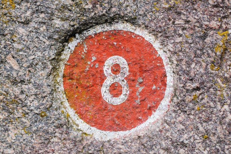 Number 8 painted inside a red circle, stock photo