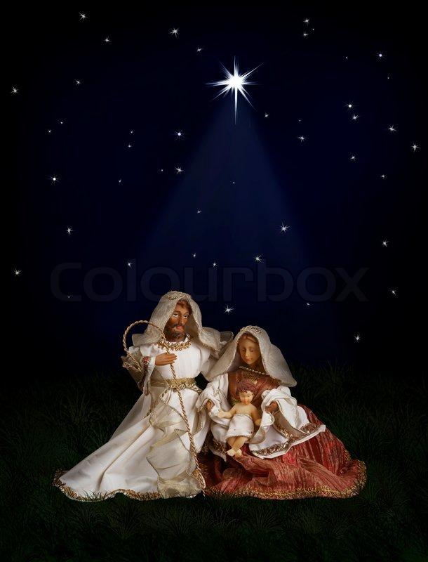 Nativity scene with Mary, Joseph, baby Jesus on dark background with ...