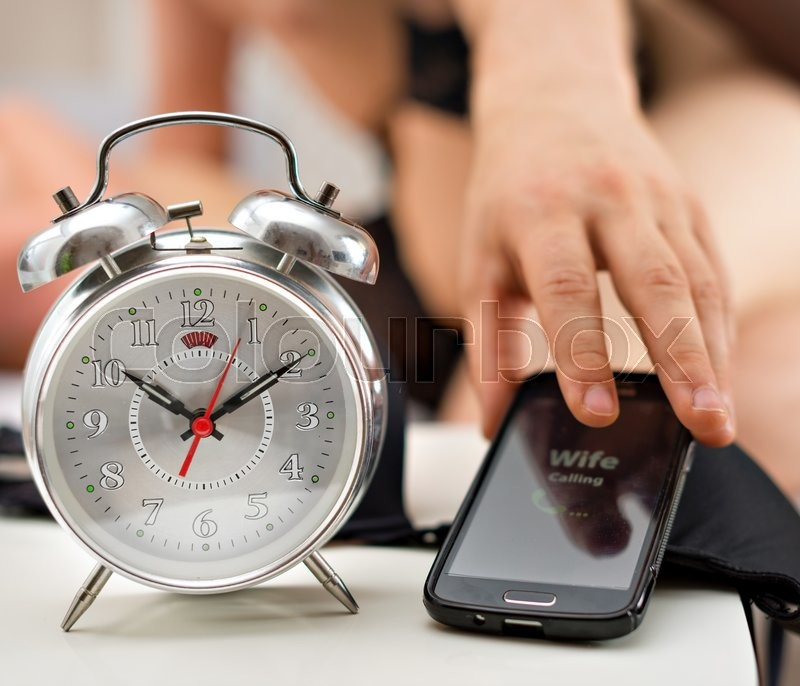 Husband is cheating. Wife calling at the wrong time. , stock photo
