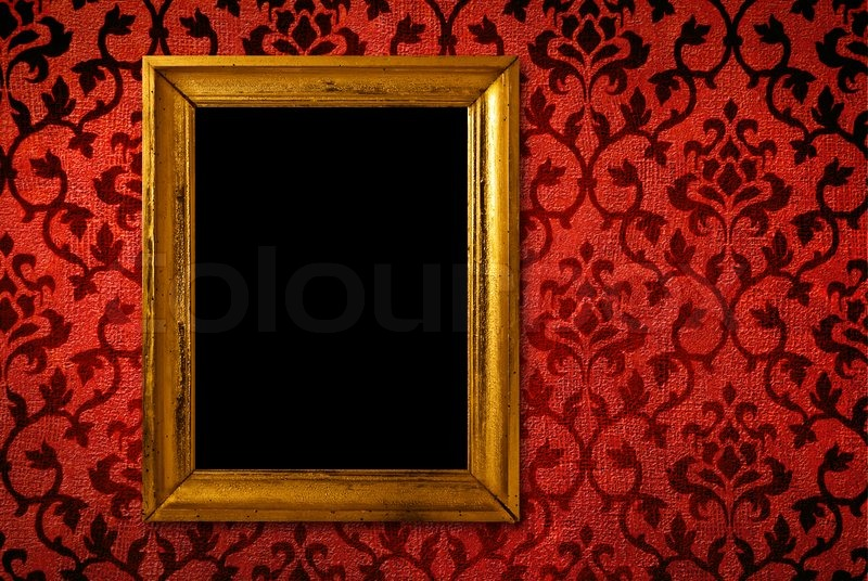 vintage wall frames. Gold frame on a vintage red wall background  stock photo Stock Photo Colourbox