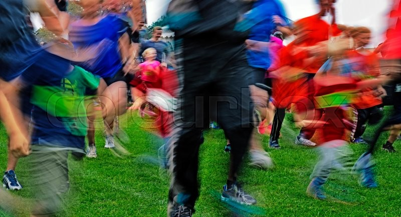 Crowd of people running just after start - Blurred competition picture, stock photo