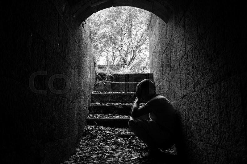 Young Sad Man Sitting Inside Of Dark Stock Image Colourbox