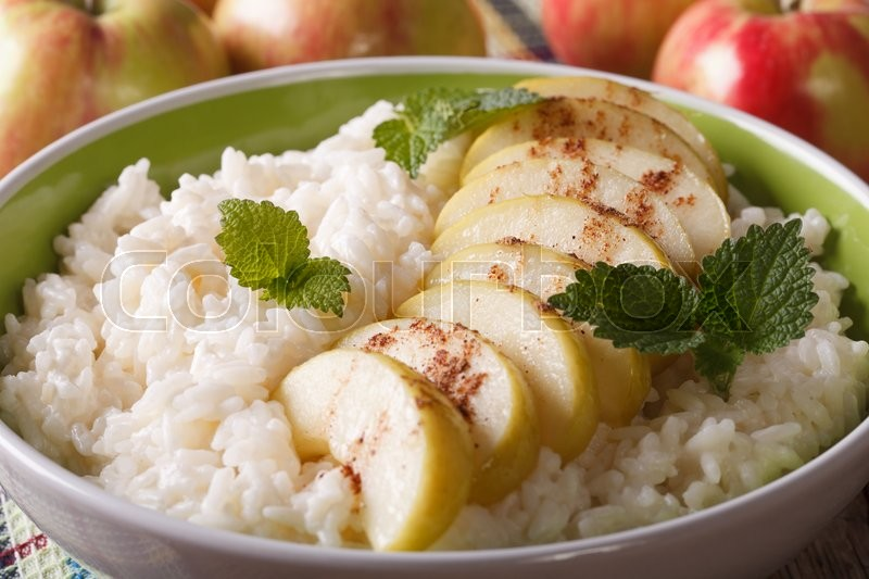 Stock image of 'rice pudding with apples and cinnamon in a bowl macro ...