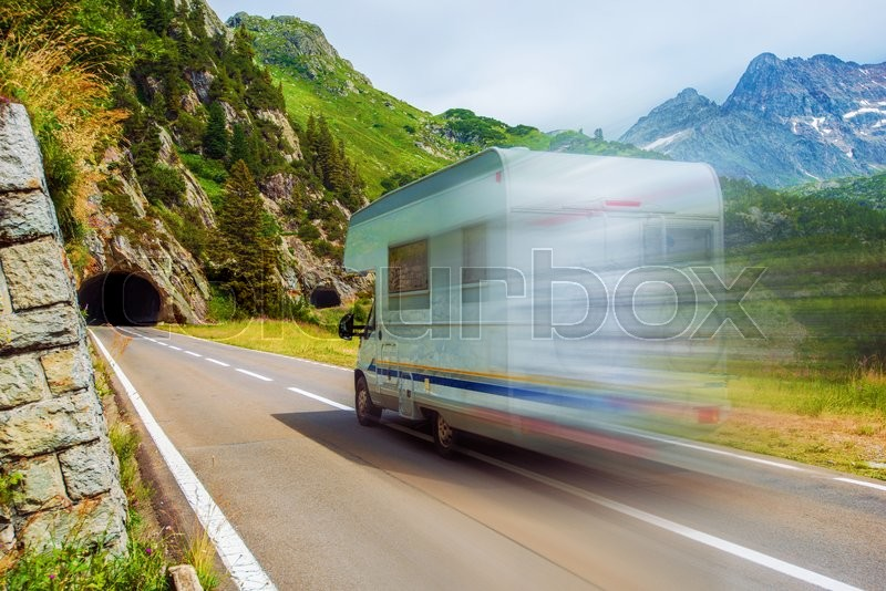 Speeding Camper on a Mountain Road. Class C Recreational Vehicle. Vacation Adventures, stock photo