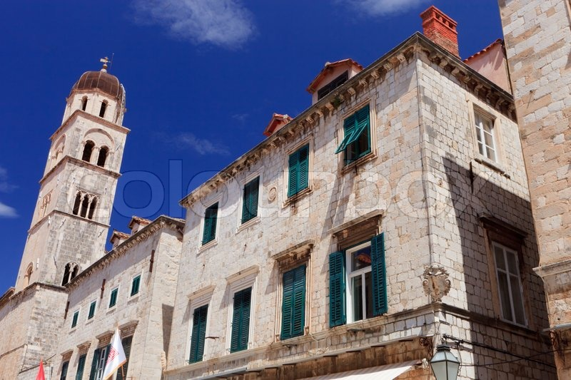 Stock image of 'Church bell tower and buildings in Dubrovnik old town ...