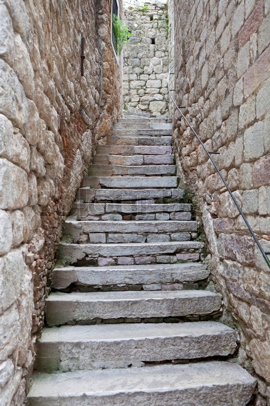 Old Stone Stairs Between Two Stone Walls Stock Photo