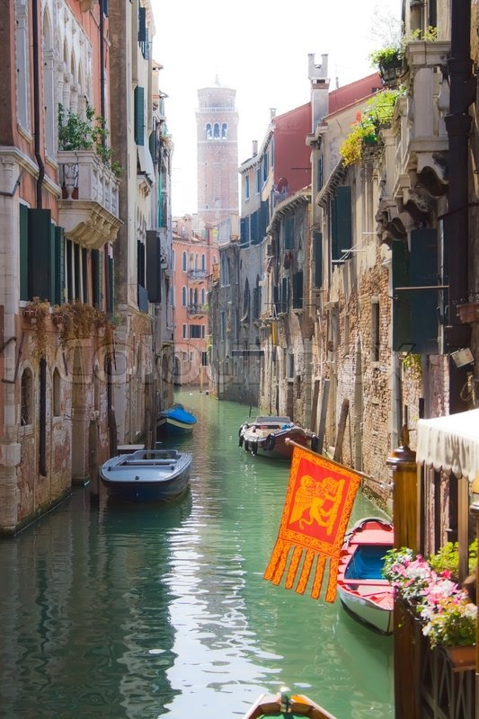 Beautiful canal and traditional venetian flag, Venice, Italy | Stock Photo | Colourbox